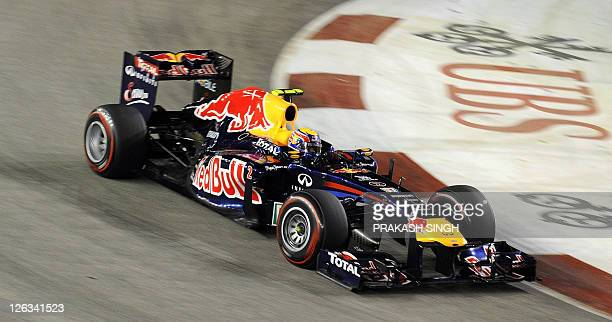 Red Bull-Renault driver Mark Webber of Australia powers his car during Formula One's Singapore Grand Prix night race in Singapore on September 25,...