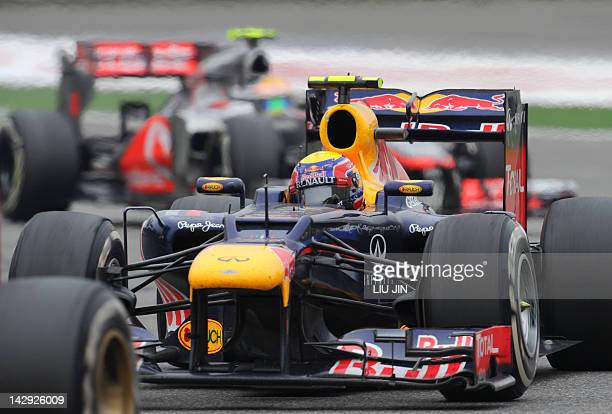 Red Bull-Renault driver Mark Webber of Australia powers his car during the race of Formula One's Chinese Grand Prix at the Shanghai International...