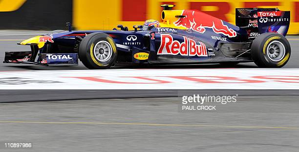 Red Bull-Renault driver Mark Webber of Australia runs his race car through a corner during the final practice session for Formula One's Australian...