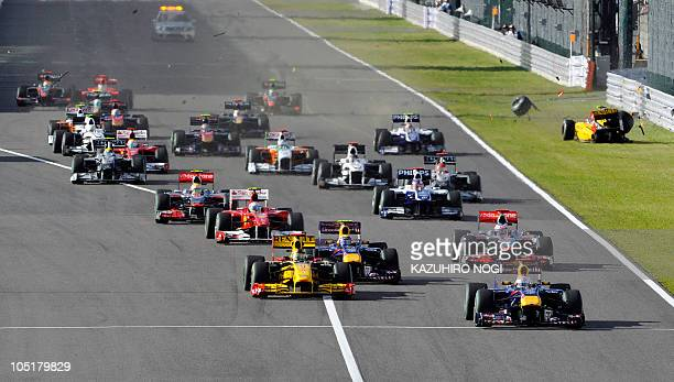 Red BullRenault driver Sebastian Vettel of Germany leads the pack after the start of Formula One's Japanese Grand Prix at Suzuka on October 10 2010...