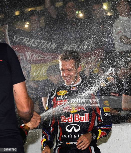 Red BullRenault driver Sebastian Vettel of Germany receives a champagne shower from members of his team as they gather to celebrate his win in the...