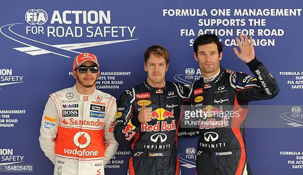 Red BullRenault driver Sebastian Vettel of Germany Red BullRenault driver Mark Webber of Australia and McLarenMercedes driver Lewis Hamilton of...