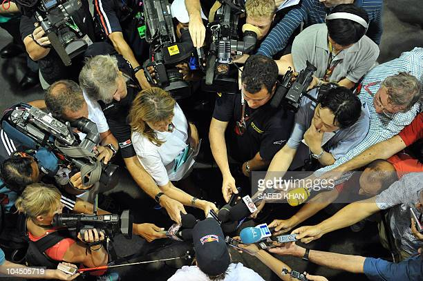 Red BullRenault driver Sebastian Vettel of Germany talks to media after the second practice session of Formula One's Singapore Grand Prix at the...