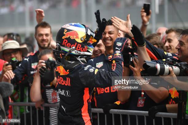 Red Bull's Australian driver Daniel Ricciardo celebrates his third place in the Formula One Austria Grand Prix at the Red Bull Ring in Spielberg on...