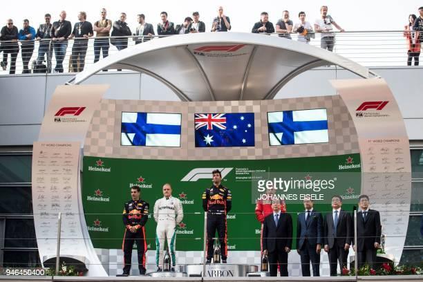 Red Bull's Australian driver Daniel Ricciardo celebrates his victory with secondplaced Mercedes' Finnish driver Valtteri Bottas and thirdplaced...