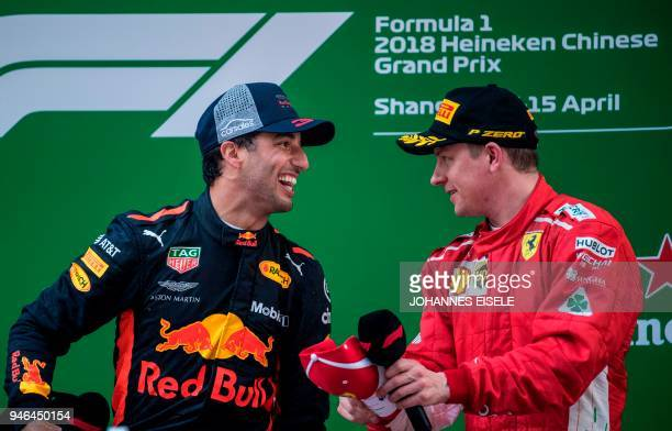Red Bull's Australian driver Daniel Ricciardo celebrates on the podium after winning the Formula One Chinese Grand Prix in Shanghai with thirdplaced...