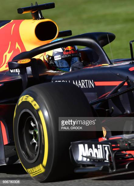 Red Bull's Australian driver Daniel Ricciardo drives around the Albert Park circuit during the second Formula One practice session in Melbourne on...