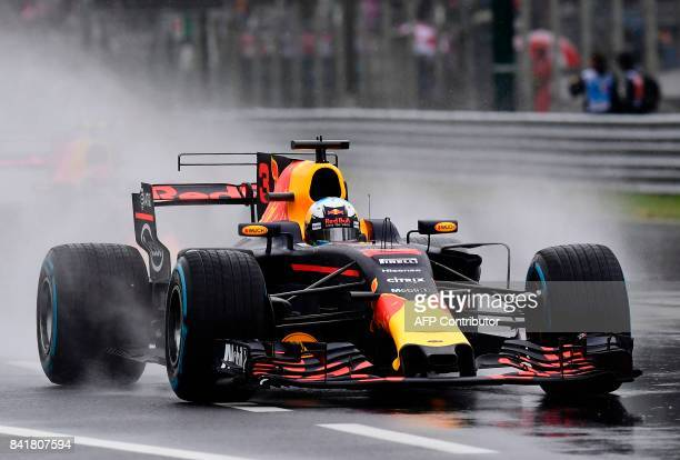 Red Bull's Australian driver Daniel Ricciardo drives as it rains during the third practice session at the Autodromo Nazionale circuit in Monza on...