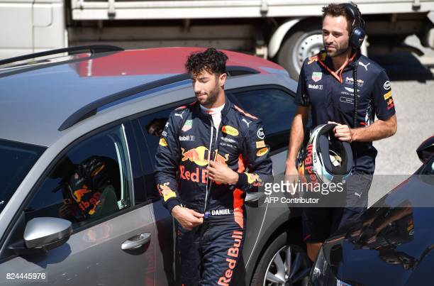 Red Bull's Australian driver Daniel Ricciardo leaves the Hungaroring racing circuit in Budapest on July 30 during the Formula One Hungarian Grand...