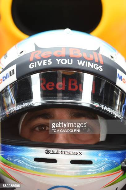 Red Bull's Australian driver Daniel Ricciardo looks at a screen in the pits during the first practice session at the Circuit de Catalunya on May 12...