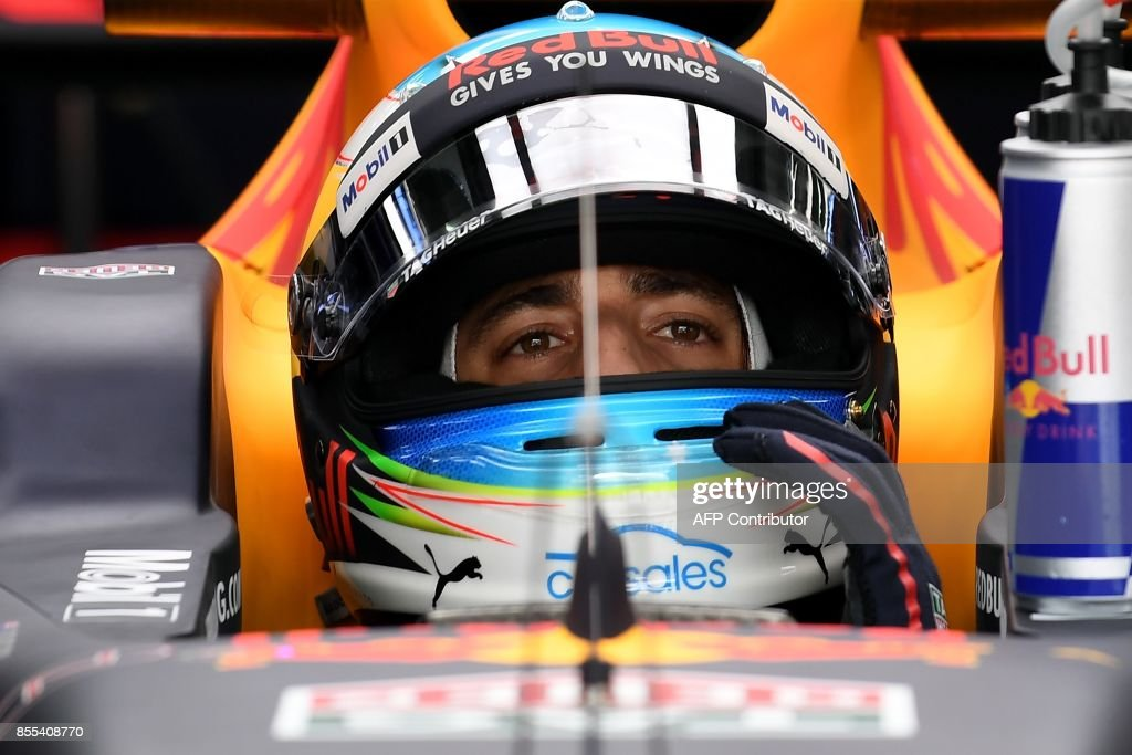 Red Bull's Australian driver Daniel Ricciardo prepares to drive out of the pit during the second practice session of the Formula One Malaysia Grand Prix in Sepang on September 29, 2017. /