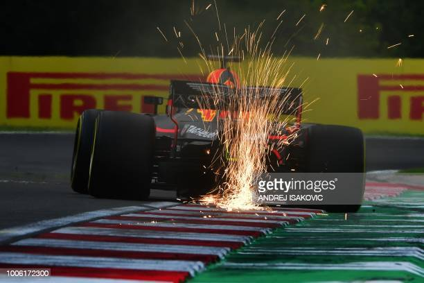 TOPSHOT Red Bull's Australian driver Daniel Ricciardo steers his car during the second free practice session ahead of the Formula One Hungarian Grand...