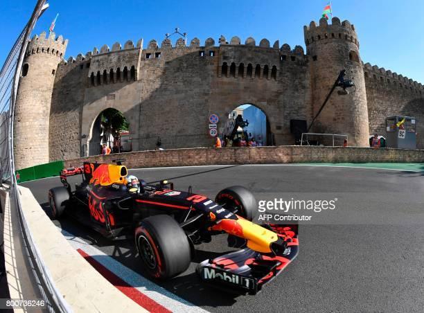 TOPSHOT Red Bull's Australian driver Daniel Ricciardo steers his car during the Formula One Azerbaijan Grand Prix at the Baku City Circuit in Baku on...