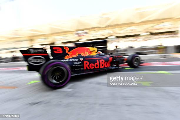 Red Bull's Australian driver Daniel Ricciardo steers his car during the third practice session ahead of the Abu Dhabi Formula One Grand Prix at the...