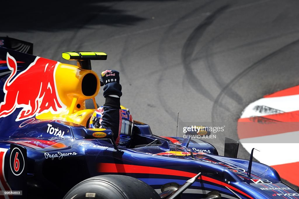 Red Bull's Australian driver Mark Webber celebrates at the Monaco street circuit on May 16, 2010, after the Monaco Formula One Grand Prix. Red Bull's Australian driver Mark Webber won the race ahead of Red Bull's German driver Sebastian Vettel and Renault f1's Polish driver Robert Kubica.