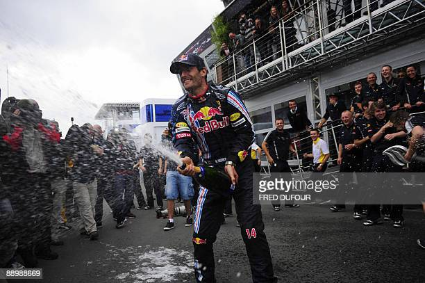 Red Bull's Australian driver Mark Webber celebrates his victory in front of his team's motorhome in the paddock of the Nurburgring racetrack on July...