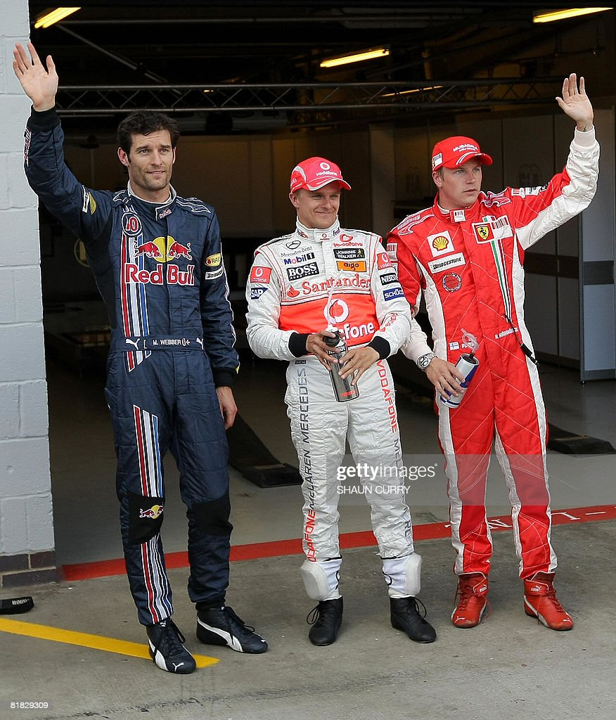 Red Bull's Australian driver Mark Webber, McLaren Mercedes' Finnish driver Heikki Kovalainen and Ferrari's Finnish driver Kimi Raikkonen salute in the parc ferme of the Silverstone racetrack on July 5, 2008 in Silverstone, England, after the qualifying session of the Formula One British Grand Prix. McLaren Mercedes' Finnish driver Heikki Kovalainen clocked the best time ahead of Red Bull's Australian driver Mark Webber and Ferrari's Finnish driver Kimi Raikkonen.