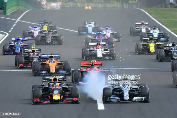 TOPSHOT Red Bull's Dutch driver Max Verstappen and Mercedes' Finnish driver Valtteri Bottas compete during the Formula One Hungarian Grand Prix at...