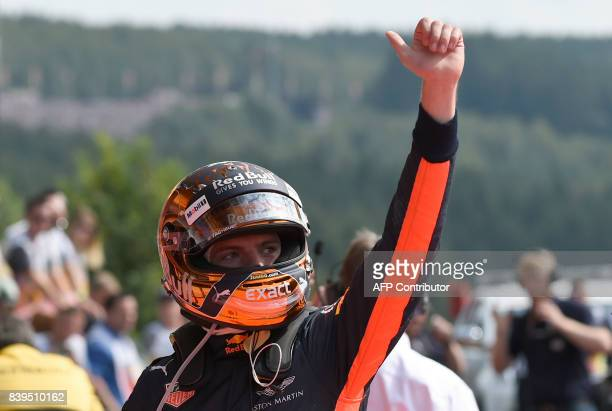 Red Bull's Dutch driver Max Verstappen celebrates after placing fifth in the qualifying session at the SpaFrancorchamps circuit in Spa on August 26...