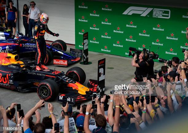 Red Bull's Dutch driver Max Verstappen celebrates after winning the F1 Brazil Grand Prix at the Interlagos racetrack in Sao Paulo Brazil on November...