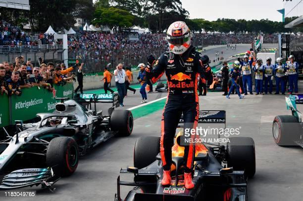 Red Bull's Dutch driver Max Verstappen celebrates after winning the F1 Brazil Grand Prix at the Interlagos racetrack in Sao Paulo Brazil on November...