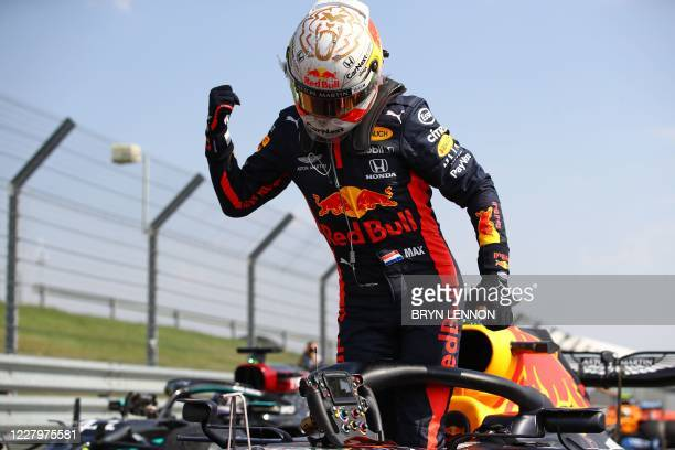 Red Bull's Dutch driver Max Verstappen celebrates after winning the race during the F1 70th Anniversary Grand Prix at Silverstone on August 9, 2020...