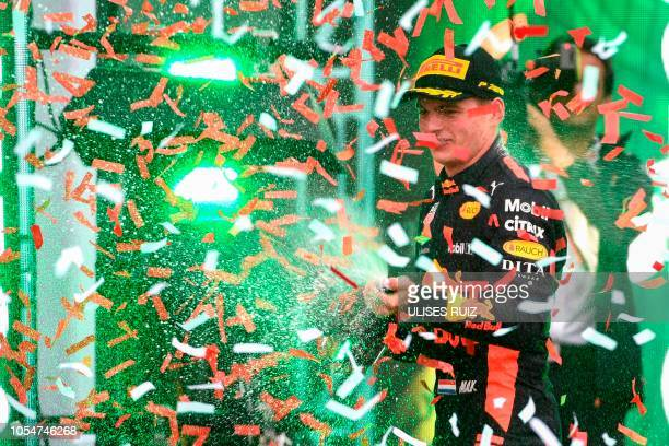 TOPSHOT Red Bull's Dutch driver Max Verstappen celebrates on the podium after winning the F1 Mexico Grand Prix at the Hermanos Rodriguez circuit in...