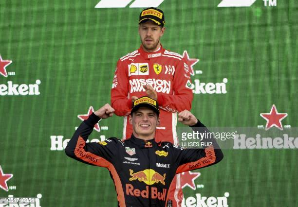 Red Bull's Dutch driver Max Verstappen celebrates on the podium after winning the F1 Mexico Grand Prix as runnerup Ferrari's German driver Sebastian...