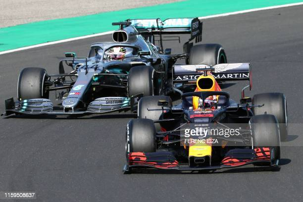 Red Bull's Dutch driver Max Verstappen competes next to Mercedes' British driver Lewis Hamilton during the Formula One Hungarian Grand Prix at the...