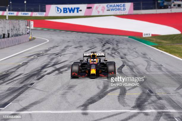 Red Bull's Dutch driver Max Verstappen crosses the finish line to take the first place and claim the pole position after the qualifying session at...