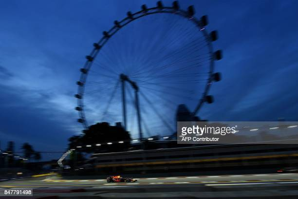 TOPSHOT Red Bull's Dutch driver Max Verstappen drives during the third practice session of the Formula One Singapore Grand Prix in Singapore on...