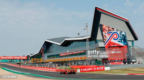 Red Bull's Dutch driver Max Verstappen drives onto the straight for his last lap during the F1 70th Anniversary Grand Prix at Silverstone on August...