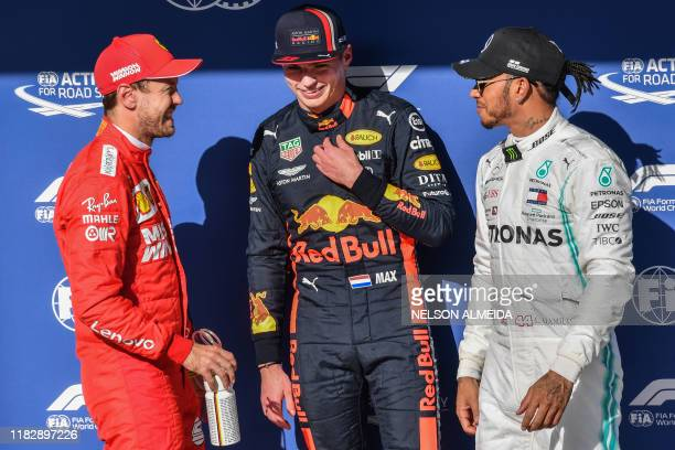 Red Bull's Dutch driver Max Verstappen Ferrari's German driver Sebastian Vettel and Mercedes' British driver Lewis Hamilton chat as they pose after...