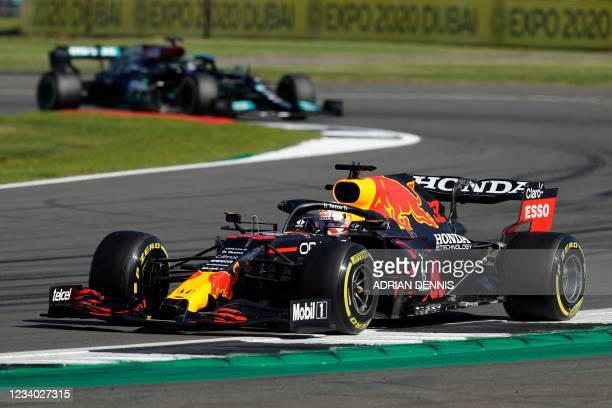 Red Bull's Dutch driver Max Verstappen leads Mercedes' British driver Lewis Hamilton during the sprint session of the Formula One British Grand Prix...