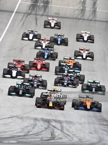 Red Bull's Dutch driver Max Verstappen leads the pack as drivers take the start of the Formula One Austrian Grand Prix at the Red Bull Ring race...