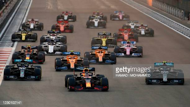 Red Bull's Dutch driver Max Verstappen leads the pack at the start of the Abu Dhabi Formula One Grand Prix at the Yas Marina Circuit in the Emirati...