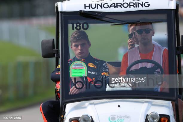 TOPSHOT Red Bull's Dutch driver Max Verstappen looks on as he is escorted off the circuit during the Formula One Hungarian Grand Prix at the...