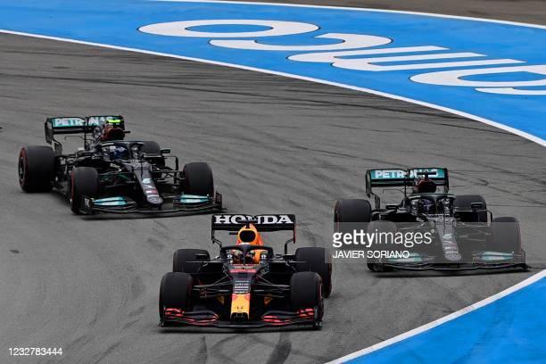 Red Bull's Dutch driver Max Verstappen, Mercedes' British driver Lewis Hamilton and Mercedes' Finnish driver Valtteri Bottas take the start of the...