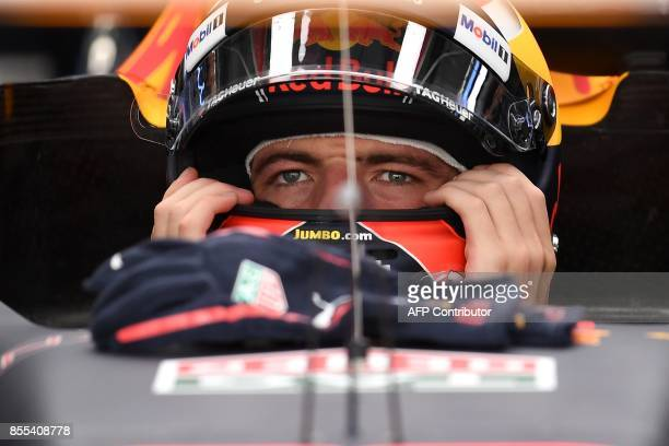 Red Bull's Dutch driver Max Verstappen prepares to drive out of the pit during the second practice session of the Formula One Malaysia Grand Prix in...