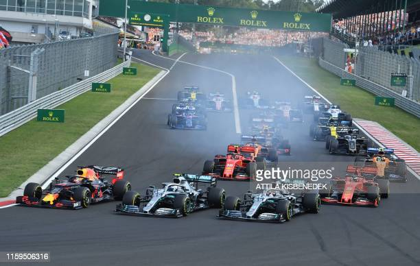 Red Bull's Dutch driver Max Verstappen starts the race from the pole position during the Formula One Hungarian Grand Prix at the Hungaroring circuit...