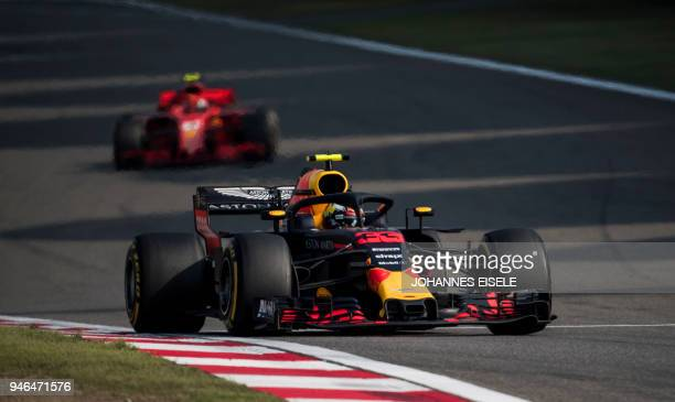 Red Bull's Dutch driver Max Verstappen steers his car during Formula One Chinese Grand Prix in Shanghai on April 15 2018 / AFP PHOTO / Johannes EISELE