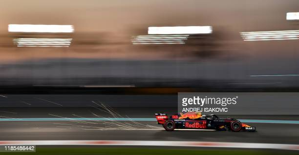 Red Bull's Dutch driver Max Verstappen steers his car during the second practice session on November 29 at the Yas Marina Circuit in Abu Dhabi, two...