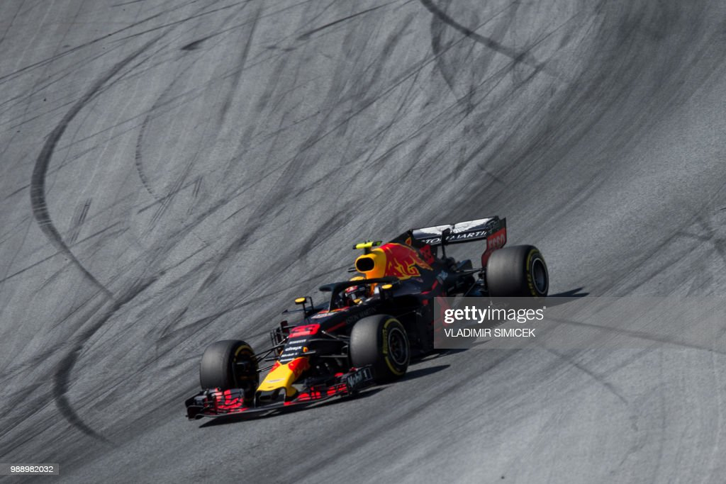 TOPSHOT - Red Bull's Dutch driver Max Verstappen steers his car during the Austrian Formula One Grand Prix in Spielberg, central Austria, on July 1, 2018.
