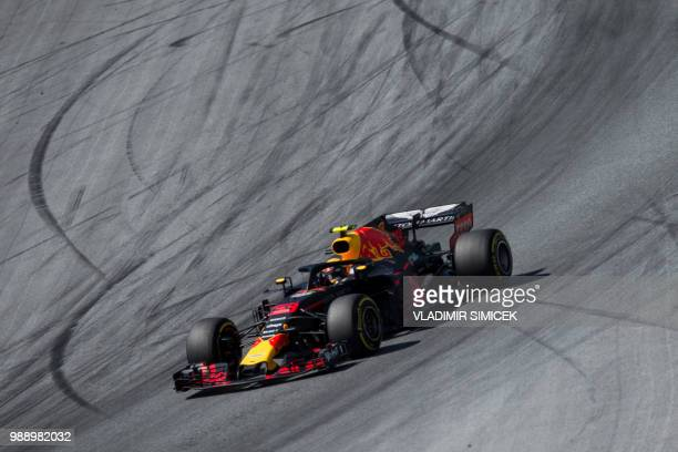 TOPSHOT Red Bull's Dutch driver Max Verstappen steers his car during the Austrian Formula One Grand Prix in Spielberg central Austria on July 1 2018