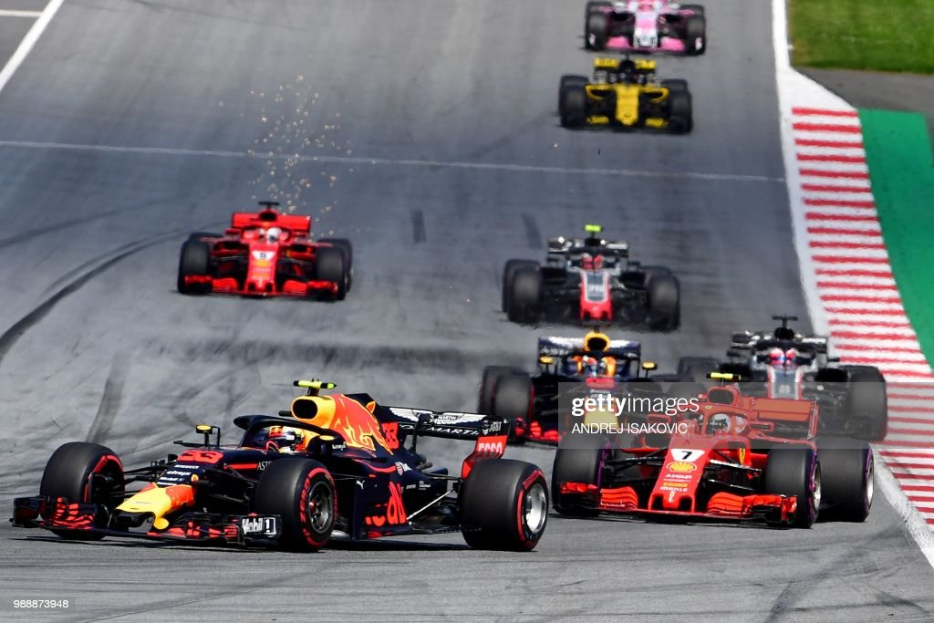 Red Bull's Dutch driver Max Verstappen (L) steers his car in front of Ferrari's Finnish driver Kimi Raikkonen (R) during the Austrian Formula One Grand Prix in Spielberg, central Austria, on July 1, 2018.