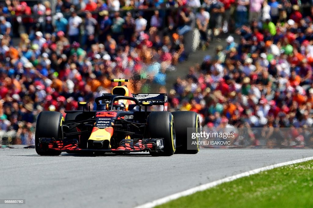 TOPSHOT - Red Bull's Dutch driver Max Verstappen steers his car to victory during the Austrian Formula One Grand Prix in Spielberg, central Austria, on July 1, 2018.