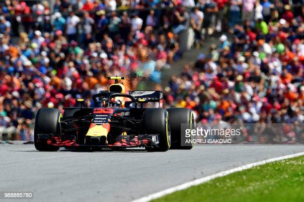 TOPSHOT Red Bull's Dutch driver Max Verstappen steers his car to victory during the Austrian Formula One Grand Prix in Spielberg central Austria on...