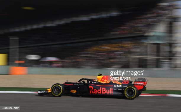 Red Bull's Dutch driver Max Verstappen takes a corner during the Formula One Chinese Grand Prix in Shanghai on April 15 2018 / AFP PHOTO / GREG BAKER