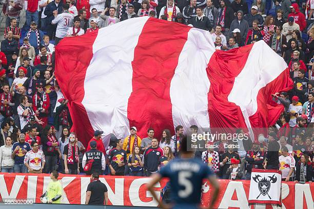 Red Bulls fans wave the Red and White Flag during match between Red Bulls and LA Galaxy Red Bulls won the match with a score of 10 at the Red Bull...