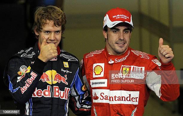 Red Bull's German driver Sebastian Vettel and Ferrari's Spanish driver Fernando Alonso in the parc ferme of the Yas Marina circuit on November 13...